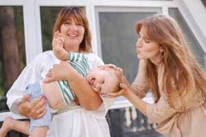 grandmother and mom with little boy
